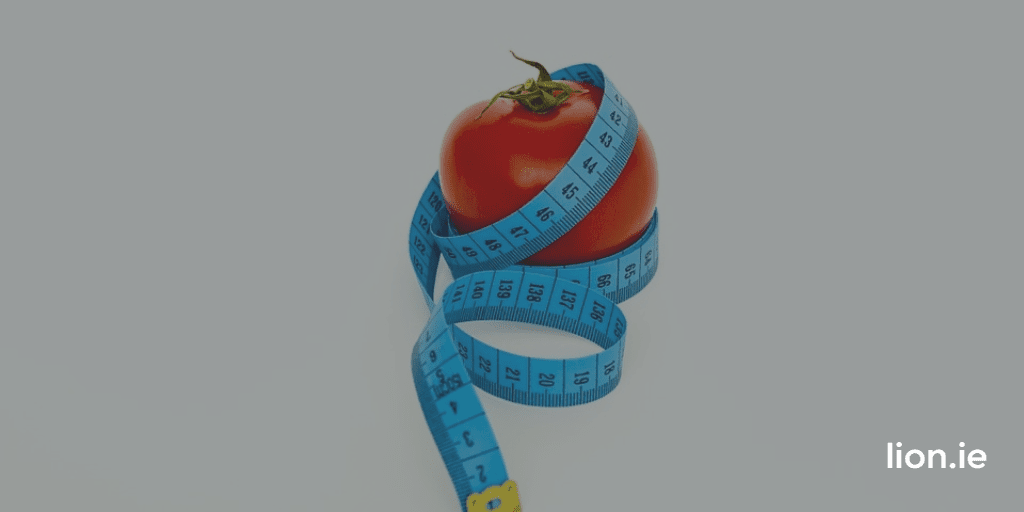 image of red tomato wrapped in a measuring tape