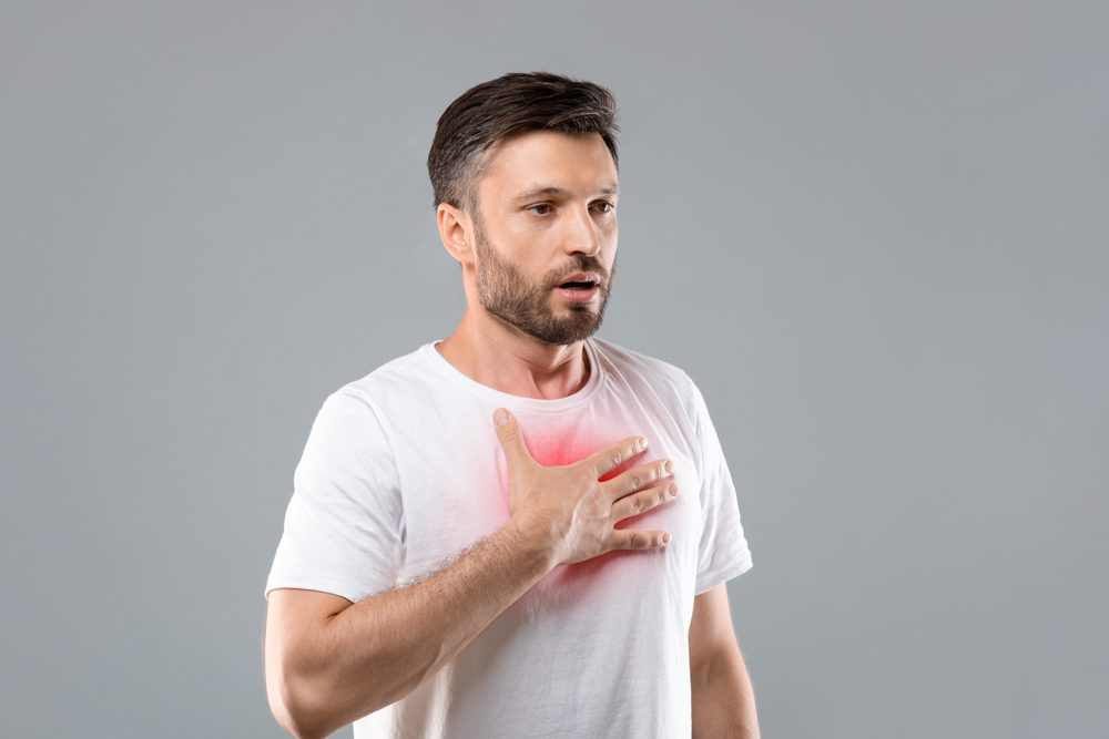 Man struggling with breathing Post Covid