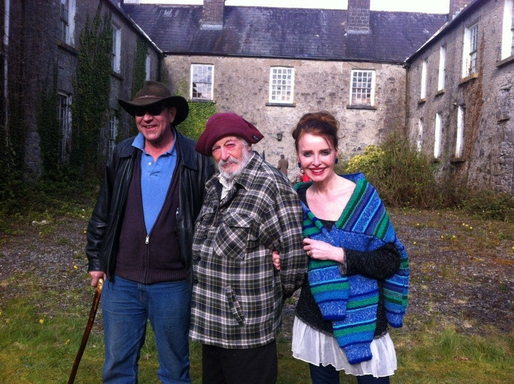 Bob Mitchell, JP Donleavy, and Polly Feversham in the courtyard