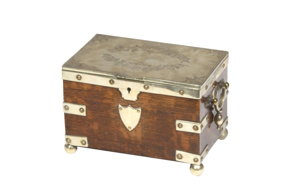 Early 19th Century Silver Bound Oak Tea Caddy with Engraved Top. With two internal compartments. Circa 1820.